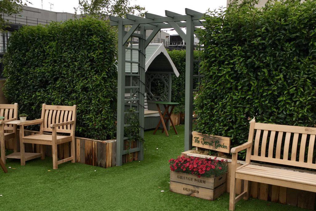 Image of Secret Garden entrance at John Lewis Summer Rooftop